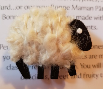 White sheep needle minder