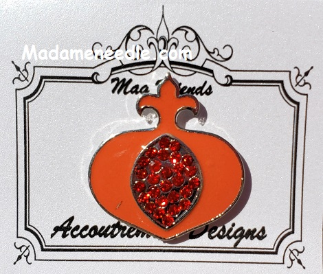 Pomegranate needle minder by Accoutrement Designs