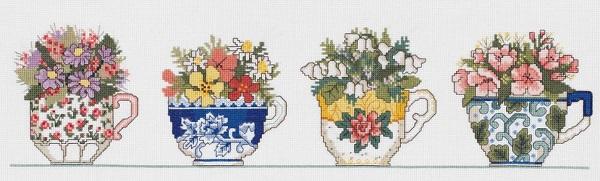 Row of teacups by Janlynn