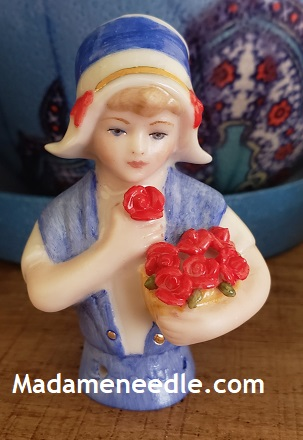 Little girl Sonja porcelain doll with red flowers