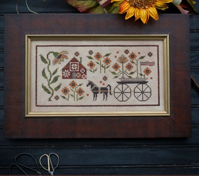 Sunflower house by Plum Street Samplers